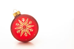 Red Christmas bauble. With golden snowflake design on white background with copy space Stock Photo