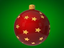 Red christmas bauble with golden stars on surface Stock Images
