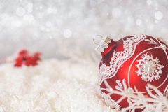 Free Red Christmas Bauble On Glitter Background Royalty Free Stock Photo - 81492745