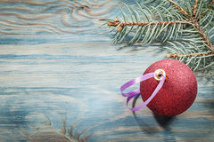 Red Christmas bauble pine brunch on wooden board holidays concep Stock Photos