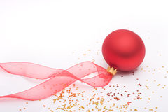 Red Christmas bauble and ribbon Royalty Free Stock Images