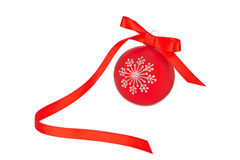Red christmas bauble with ribbon Stock Images