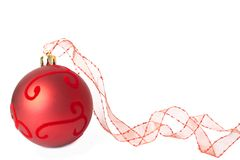 Red Christmas bauble with ribbon Royalty Free Stock Image
