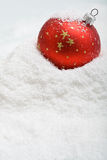 Red christmas bauble in the snow Royalty Free Stock Photography