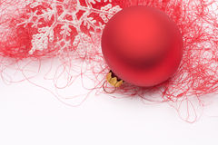 Red Christmas bauble and snowflake Stock Photography
