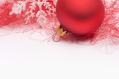 Red Christmas bauble and snowflake Royalty Free Stock Images
