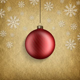 Red Christmas bauble and snowflakes Royalty Free Stock Photography