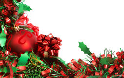 Red Christmas bauble and tinsel. Red Christmas bauble on green tinsel Stock Photo