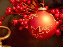 Red Christmas bauble on christmas tree Stock Photo