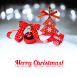 Red Christmas bauble on winter background with a caption Royalty Free Stock Image
