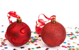 Red Christmas baubles. Two red Christmas baubles with stars Royalty Free Stock Images