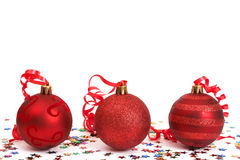 Red Christmas baubles. Three red Christmas baubles with colorful stars Stock Image