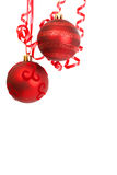 Red Christmas baubles. Two red Christmas baubles hanging on ribbons Stock Photo