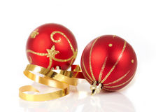 Red christmas baubles. Two red and gold christmas baubles Royalty Free Stock Photos