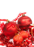 Red Christmas baubles. Four red Christmas baubles and gift box Royalty Free Stock Photo
