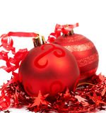 Red Christmas baubles. And tinsel isolated on white background with copy space Stock Photo