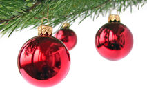 Red Christmas baubles. On white royalty free stock photo