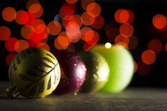 Red Christmas baubles with candle in the dark Royalty Free Stock Photo