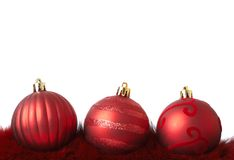 Red Christmas baubles on fur Royalty Free Stock Images