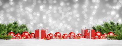 Red christmas baubles and gifts lined up 3D rendering. Red christmas baubles and gifts lined up on grey snowy background 3D rendering stock illustration
