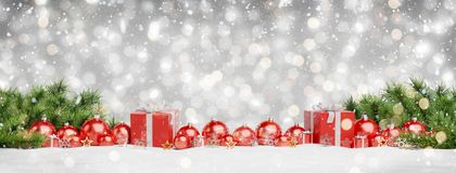 Red christmas baubles and gifts lined up 3D rendering. Red christmas baubles and gifts lined up on grey snowy background 3D rendering vector illustration