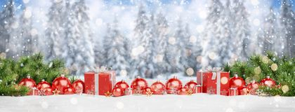 Red christmas baubles and gifts lined up 3D rendering stock illustration
