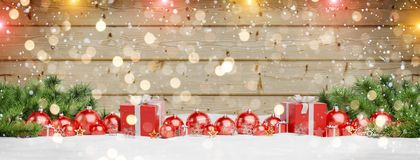 Red christmas baubles and gifts lined up 3D rendering. Red christmas baubles and gifts lined up on wood background 3D rendering royalty free illustration