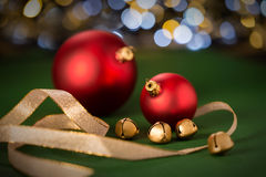 Red Christmas baubles & gold jingle bell Royalty Free Stock Photo