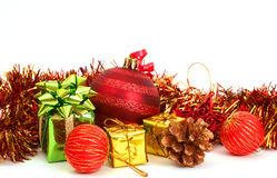 Red Christmas baubles and other decorations. On white background with copy space Royalty Free Stock Images