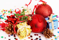 Red Christmas baubles and other decorations. On white background Royalty Free Stock Photo