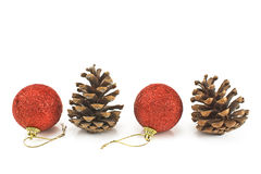 Red christmas baubles with pine cones Stock Images