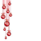 Red Christmas Baubles Red Ribbons Percents. Hanging red christmas baubles with percents on the white  background Royalty Free Stock Image