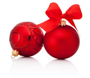 Red christmas baubles with ribbon bow  on white Stock Photos