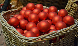 Red Christmas baubles in a rush basket Royalty Free Stock Photography