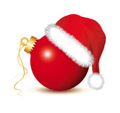 Red Christmas baubles with Santa Claus Hat Royalty Free Stock Image