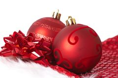 Red Christmas baubles on Santa hat Royalty Free Stock Images