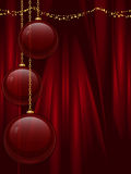 Red christmas baubles on a silk background Stock Images