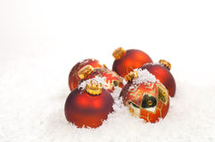 Red Christmas baubles on snow Royalty Free Stock Photos