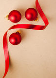 Red Christmas baubles with stylish ribbon Royalty Free Stock Photography