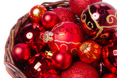 Red christmas baubles in wicker basket Stock Photos