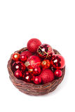 Red christmas baubles in wicker basket Royalty Free Stock Photography