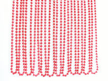 Red Christmas bead garland hanging on white Stock Images