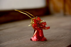 Red christmas bell. Christmas decoration red bell on wooden table Royalty Free Stock Images