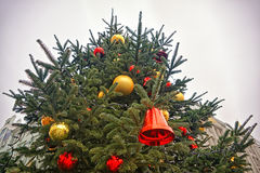 Red christmas bell and red and golden decorating balls Stock Photos