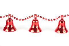 Red Christmas bells. Red Christmas decorations isolated on white background Stock Photography