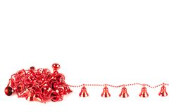 Red Christmas bells. Red Christmas decorations isolated on white background Royalty Free Stock Images