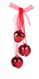Red Christmas Bells. Three red Christmas bells on ribbon Royalty Free Stock Photos