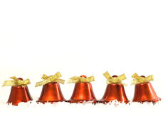 Red christmas bells. On white snow Royalty Free Stock Images
