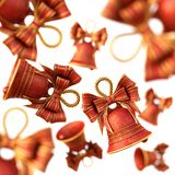 Red Christmas Bells with a bow. Stock Image