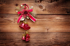 Red christmas bells on wood background. Xmas toy Stock Photography